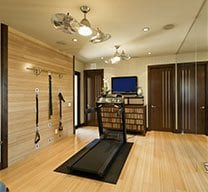 Basement with gym equipment and wooden floor