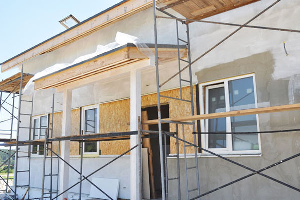 Painting and plastering the exterior of a home.